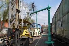 Żuraw kolejowy (kran wodny) ze stacji Trzebiatów Wąskotorowy. Pochodzi z końca XIX wieku. Korpus został odlany w formie żeliwnej kolumny, na której osadzono obrotową głowicę. Ramię wykonane ze stalowej rury